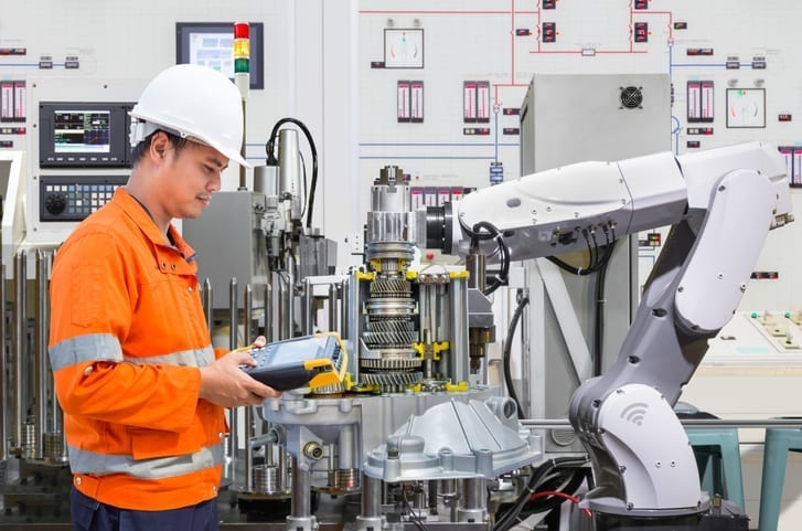 Worker using a robot with AR