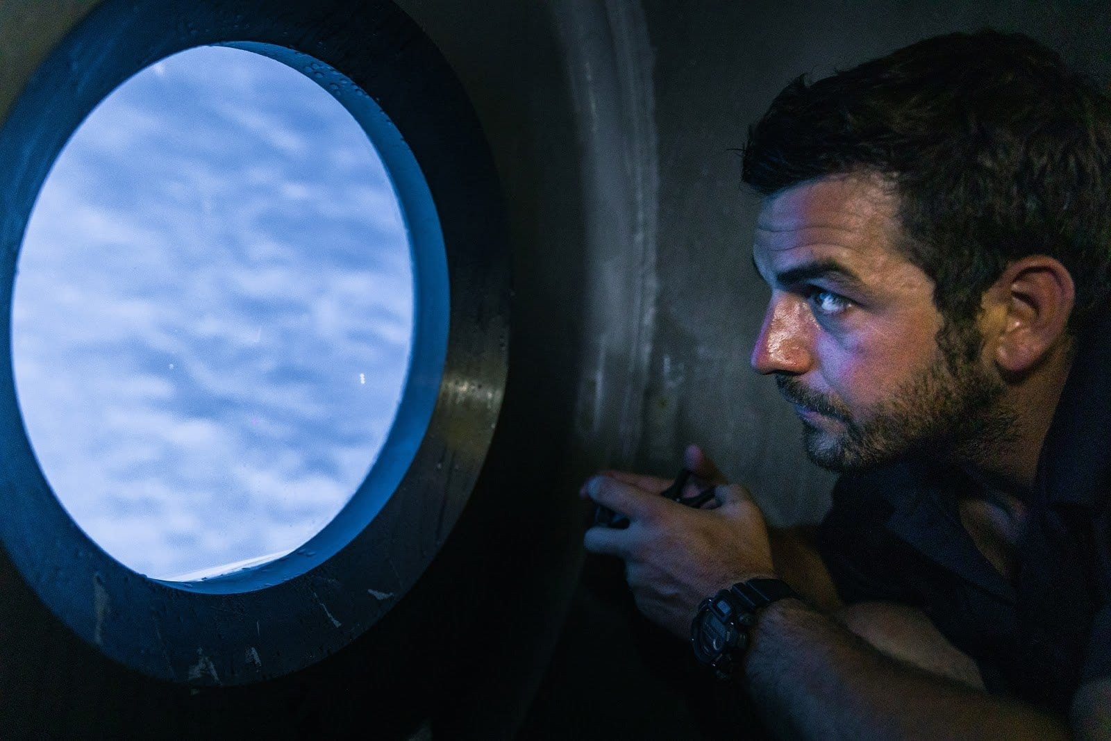 Man looking out submarine window